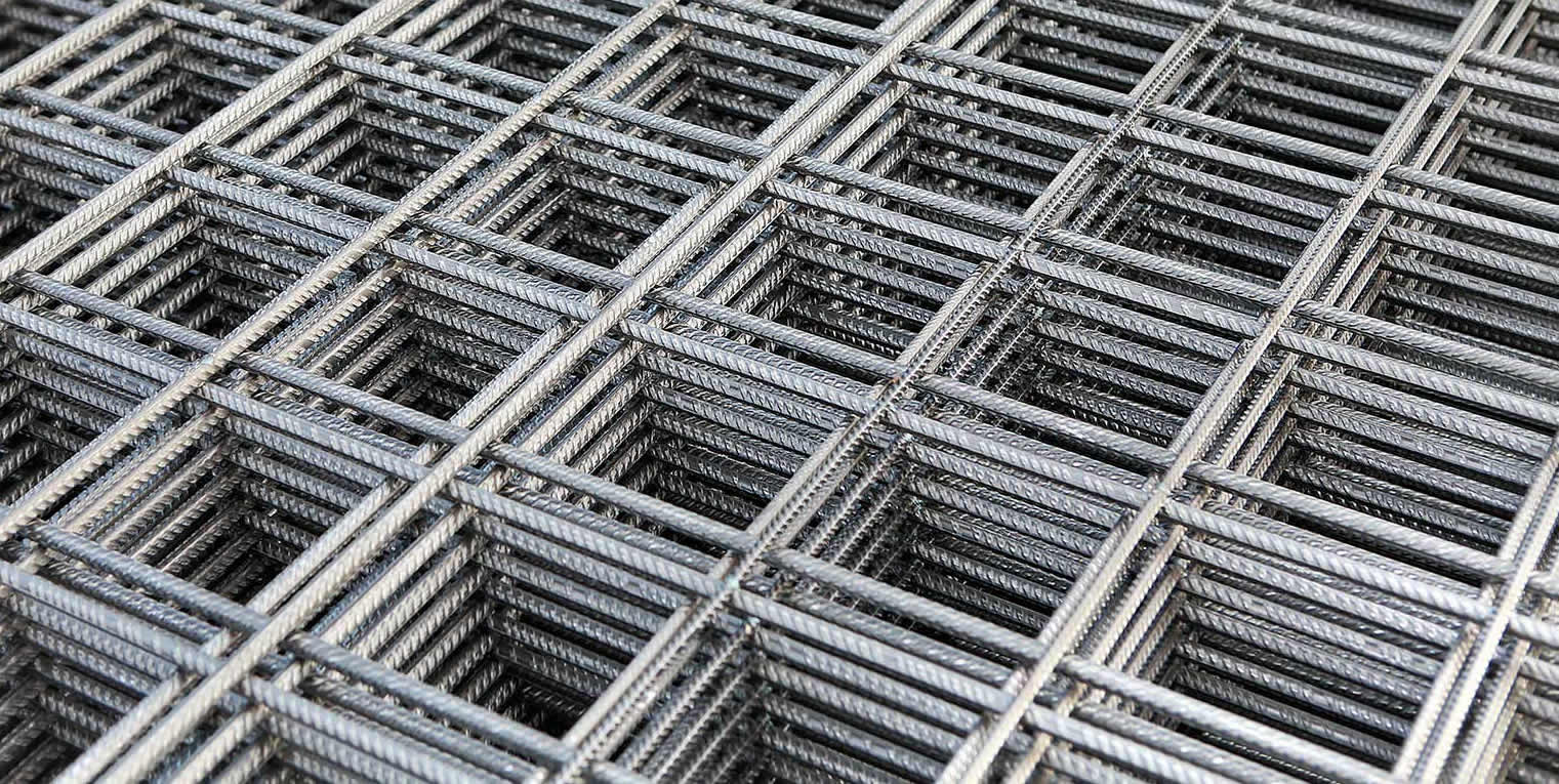 Many black reinforcing concrete welded mesh panels.